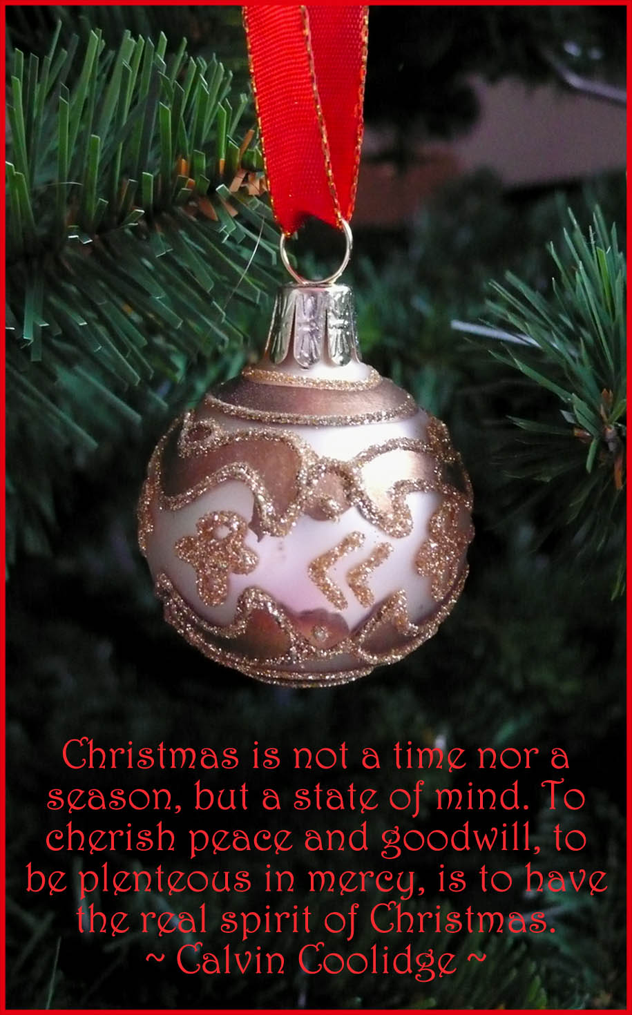Merry Christmas quote on greeting card. Picture of gold christmas ball on tree.