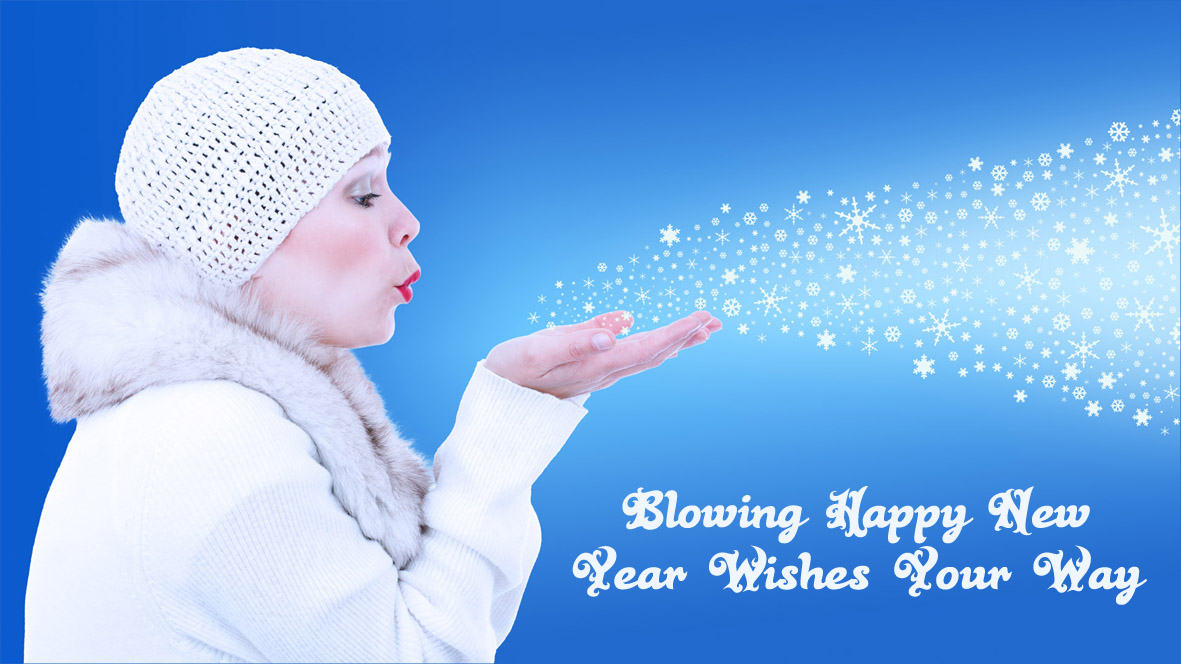Woman in white clothes blowing away snowflakes.