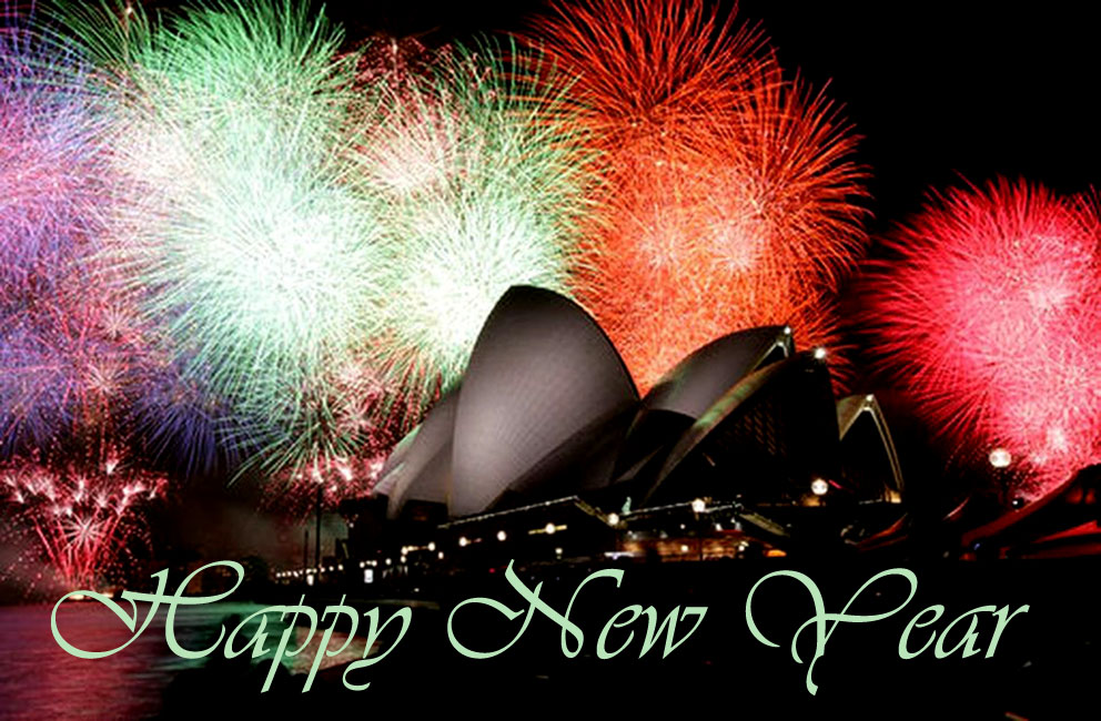 Sydney Opera House by night with colorful fireworks.