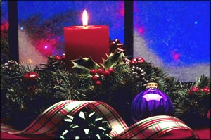 Photo of Christmas decoration and red Christmas candle burning