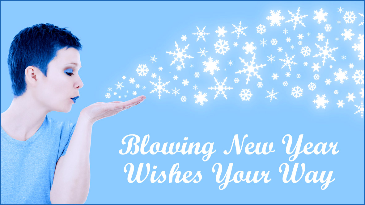 light blue new year greeting card woman blowing wishes small snowflakes