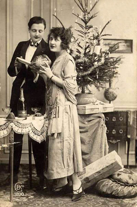 Old vintage photo couple in love at Christmas tree