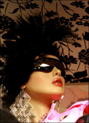 Fun retro 80s party theme. Picure of woman in pink with sunglasses.