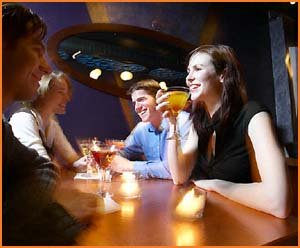 Funny birthday greetings: People laughing and having a drink.