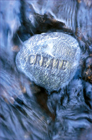 Inspirational Quotations - stone carving the word CREATE in flowing water