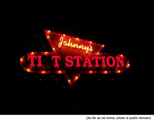 Hilarious signs: Funny neon sign with Johnny's Tit Station.