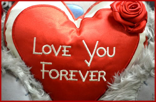 Valentine Pictures: Heart shaped pillow with red rose.