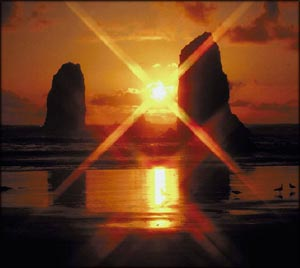 Quotes about belief: Beautiful orange sunset by the beach with the setting sun between two giant rocks.
