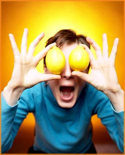 Funny Bipolar Test: Funny picture of man holding lemons in front of his eyes.