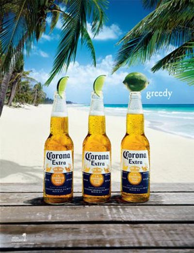 Three Corona Extra bottles on a beach: Greedy!