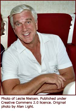 Leslie Nielsen sitting on a plane.