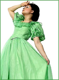 Bizarre facts: Woman in green dress holding her hand to her forehead as if she is about to faint.