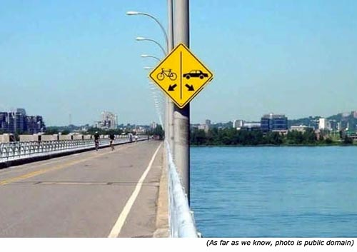 Funny traffic signs on bridge with bike and car.
