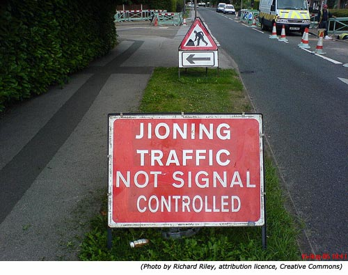 Silly signs and funny road work signs: Jioning Traffic Not Signal Controlled!