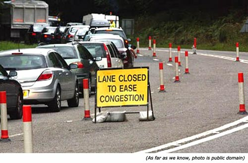 Hilarious silly sign and funny road work sign: Lane closed to ease congestion!