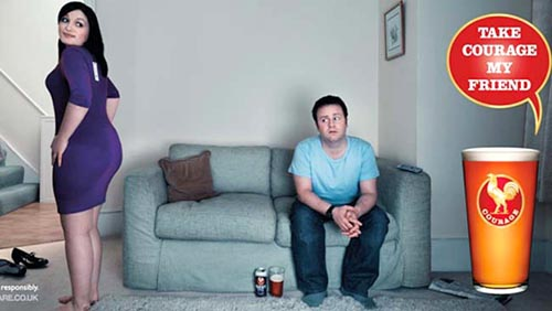 John Courage ad - Take Courage My Friend - man sitting on sofa worried when his girlfriend asks him if her bottom looks big!