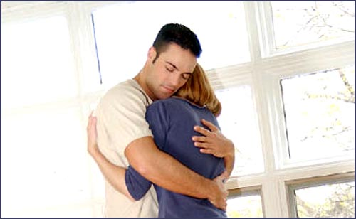Man and woman hugging. Couple embracing.