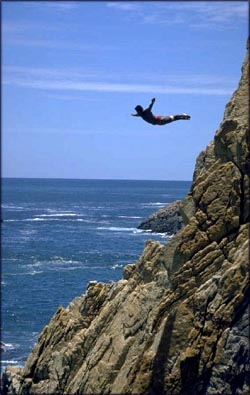 Don't let fear run your life: Man jumping out from cliff down into the water.
