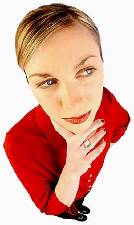 Woman in red blouse thinking about her New Years resolutions.