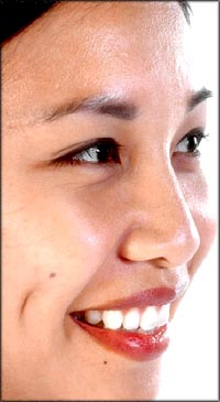 Positive quotes: Profile of Asian woman smiling.