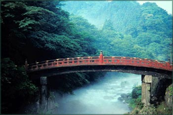 Photo of red bridge, probably Japanese bridge.