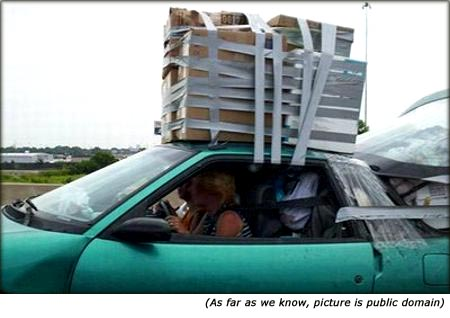 Quotes on car insurance: Funny picture of car with very big luggage on the roof.