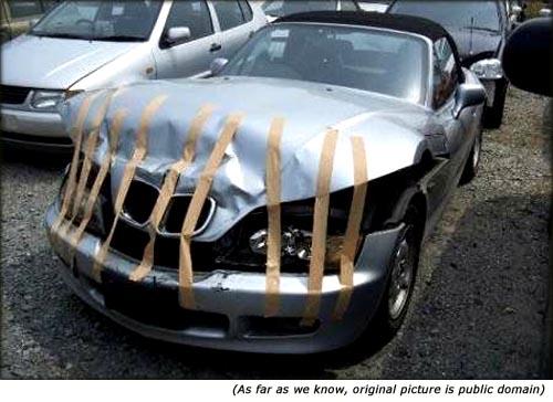 Funny car picture, car held together with duct tape.