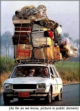Funny picture of car with too much luggage on the roof.