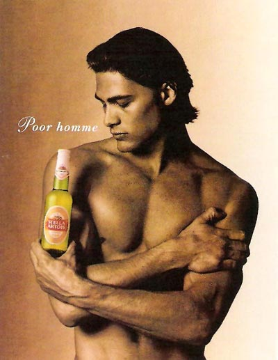 Stella Artois beer ads - Pour Homme - man holding bottle like a perfume.
