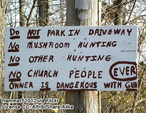 Funny warning sign: Do not park in driveway! No mushroom hunting! No other hunting! No church people ever! Owner is dangerous with gun!