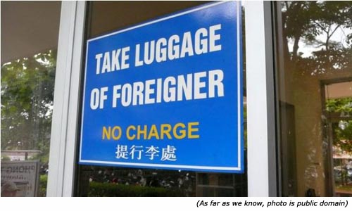 Funny airport signs: Take luggage of foreigner. No charge!