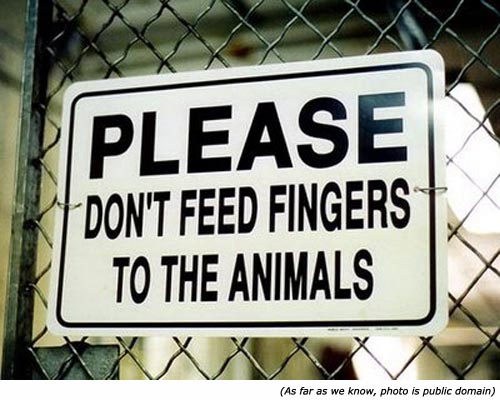 Funny warning sign and zoo signs: Please, don't feed fingers to the animals!