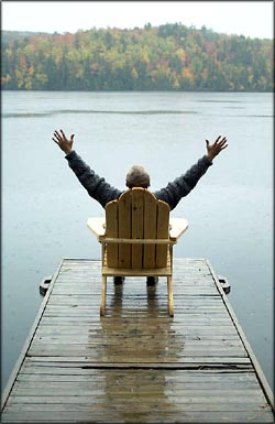 Thank you quotes: Man sitting in a chair on a small bridge with his arms out to the side.