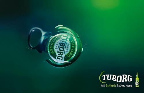 Great tuborg ads - a picture of a capsule that looks like a fish. The summer starts here