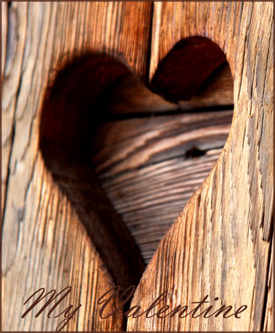 Picure of heart carved in to a wooden door.