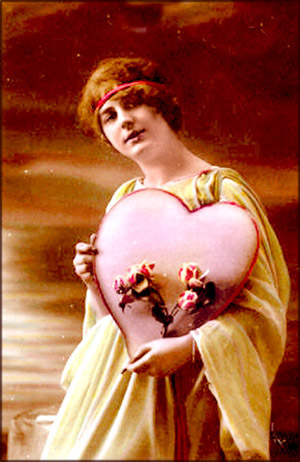 Old photo of woman with head band holding a heart and pink flowers. Beautiful Valentines Day pictures.