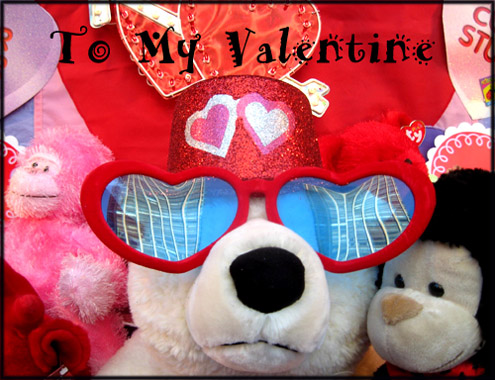 Funny Valentine cards: Photo of a teddy bear with giant sunglasses shaped as hearts and a party hat.