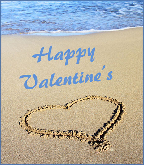 Modern Valentines Day card: heart drawn in the sand near the water.