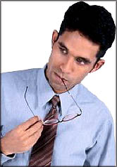 Man thinking while chewing on his glasses.