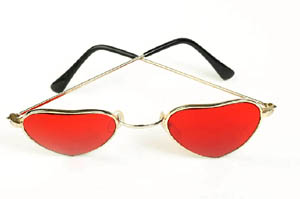 The meaning of Valentines Day: Red heart shaped glasses.