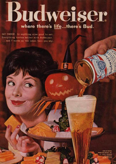 Old Budweiser commercials - Picture of a woman and a Halloween pumpkin. Budweiser: Where there's Life ... There's Bud!