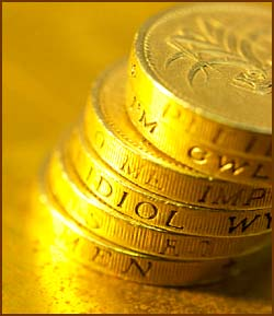 Facts about Newton and coins: Photo of stack of golden coins.