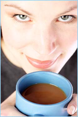 Funny facts about coffee and hallucinations: Photo of woman drinking a cup of coffee.