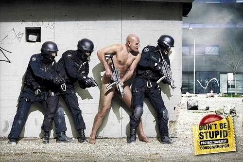 Condomshop.com funny ads - dont be stupid, protect yourself - naked man in combat