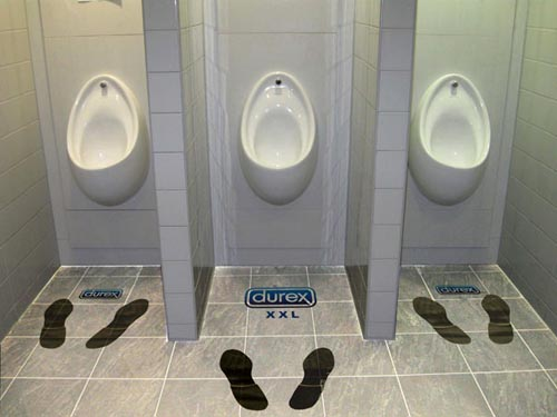 Durex funny ads: Durex xxl - footprints in toilet