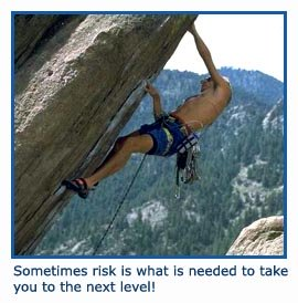 Man climber taking a risk climbing up steep rock!