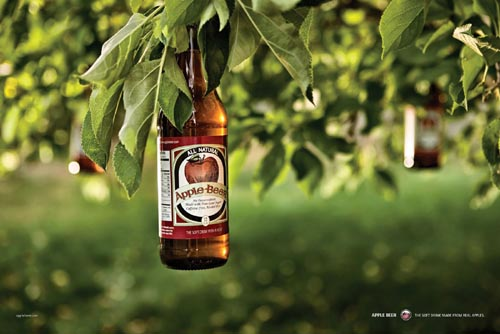 Apple bottle hanging from tree!