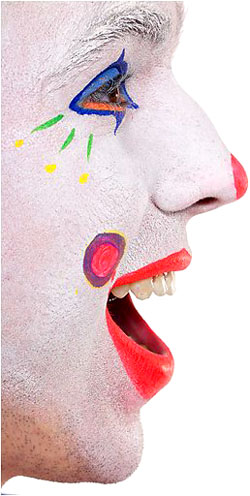 Pain jokes - laughing clown closeup photo of his face