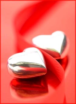 Happy birthday quotes: Cute silver hearts on red background.
