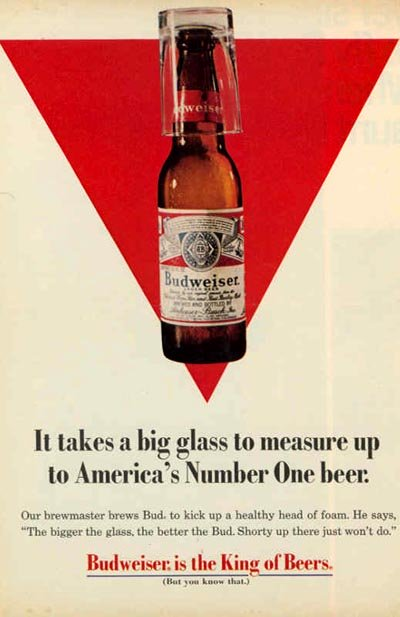 Old Budweiser ad - Red triangle background and a Budweiser bottle and glass - It takes a big glass to measure up to America's Number One beer!